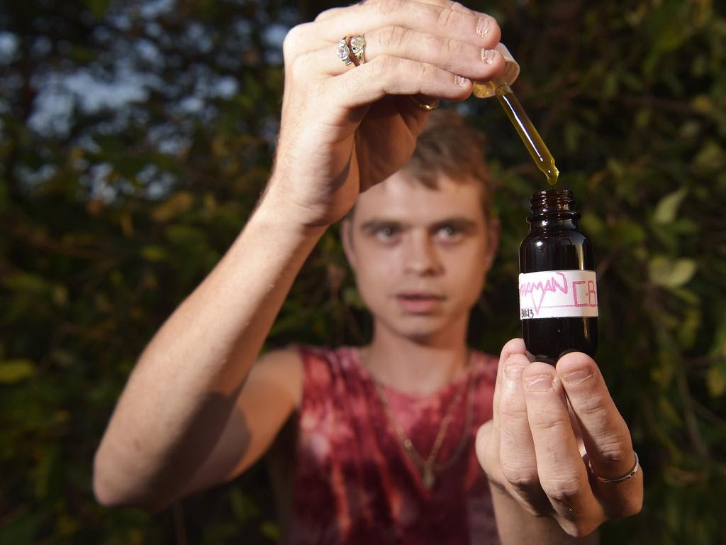 Shaman Alternative Australia owner Derick Murdoch poses for a photo with NT made CBD oil at Casuarina reserve on Friday, October 12, 2018. Picture: Keri Megelus