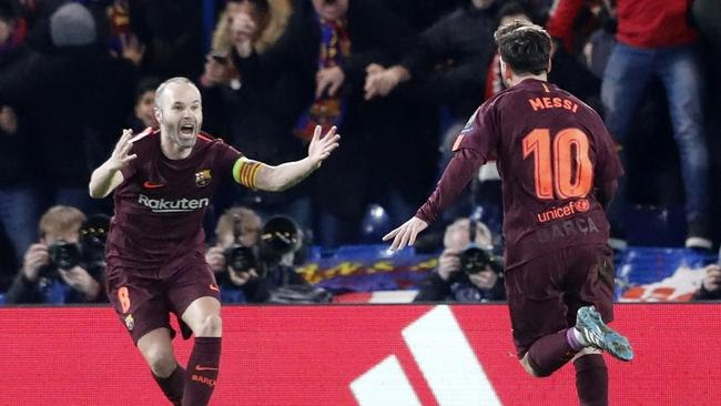 Barcelona's Lionel Messi, right, and his teammate Andres Iniesta celebratE