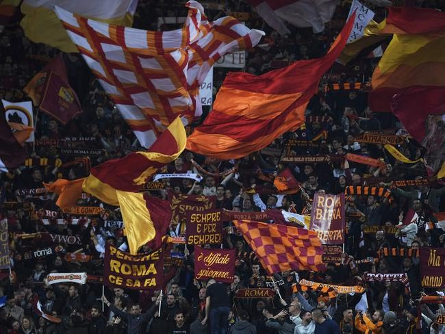 AS Roma's supporters cheer during the UEFA Champions League quarter-final