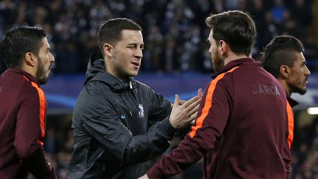 Chelsea's Belgian midfielder Eden Hazard (2nd L) winks at Barcelona's Argentinian striker Lionel Messi as they shake hands