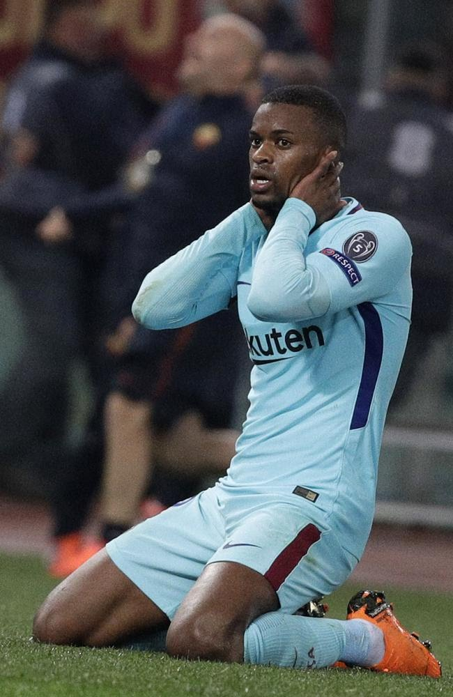Barcelona's Nelson Semedo grabs his head after Roma scored